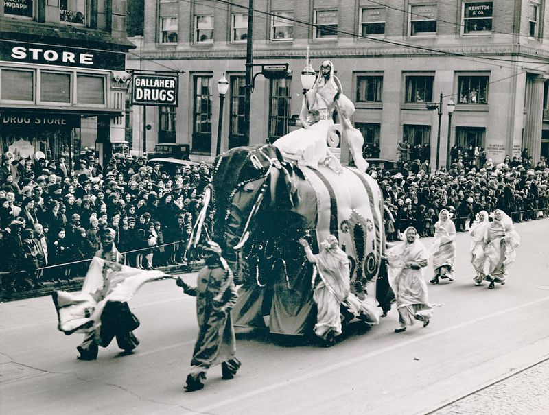 Princess Sari rides her royal elephant Jumbo through Dayton during the 1935 Rike's Thanksgiving Day Parade. The elephant was propelled by four men underneath. PHOTO COURTESY OF THE OHIO HISTORY CONNECTION